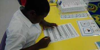 The children were enjoying being back at school by completing some activity sheets at their workstations