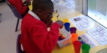 Some of the children wanted to sort through different objects in the class and put them into the correct coloured pots.