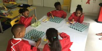 Here, the children were using paint to paint some egg boxes. They really loved the activity.