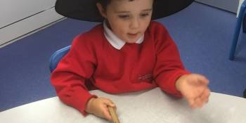 This child enjoyed role playing with the witches hat and broomstick.